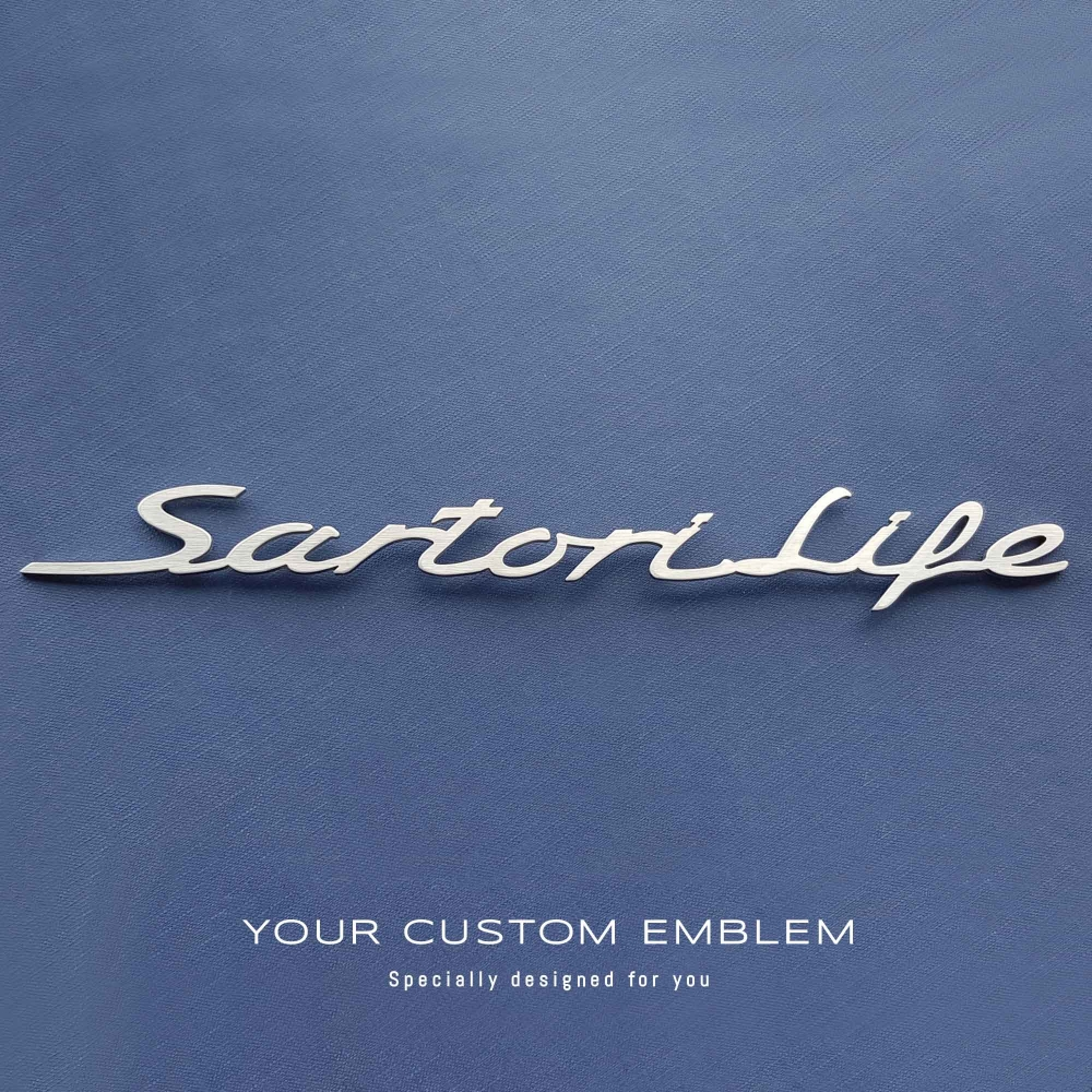 Sartori Life Emblem made of 100% stainless steel ready to be installed on a Porsche