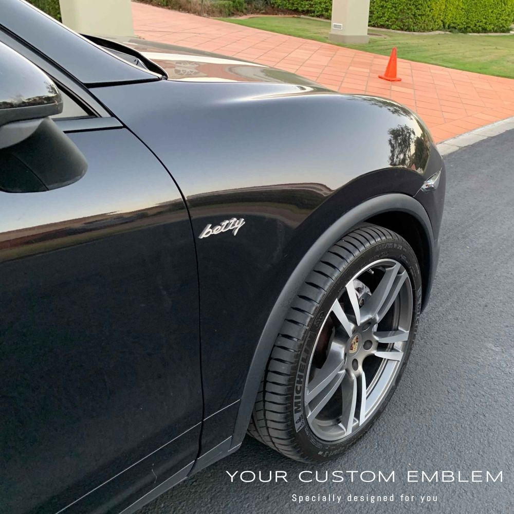 betty Emblem in 100% stainless steel installed on a Porsche Cayenne - Design done as requested