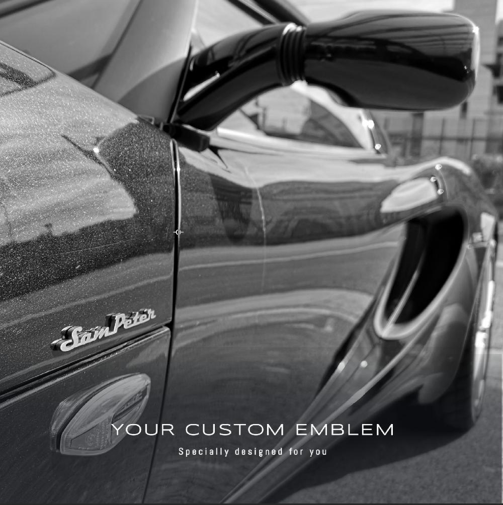 Sam Peter Emblem made in 100% stainless steel matt finishing installed on a Lotus Elise