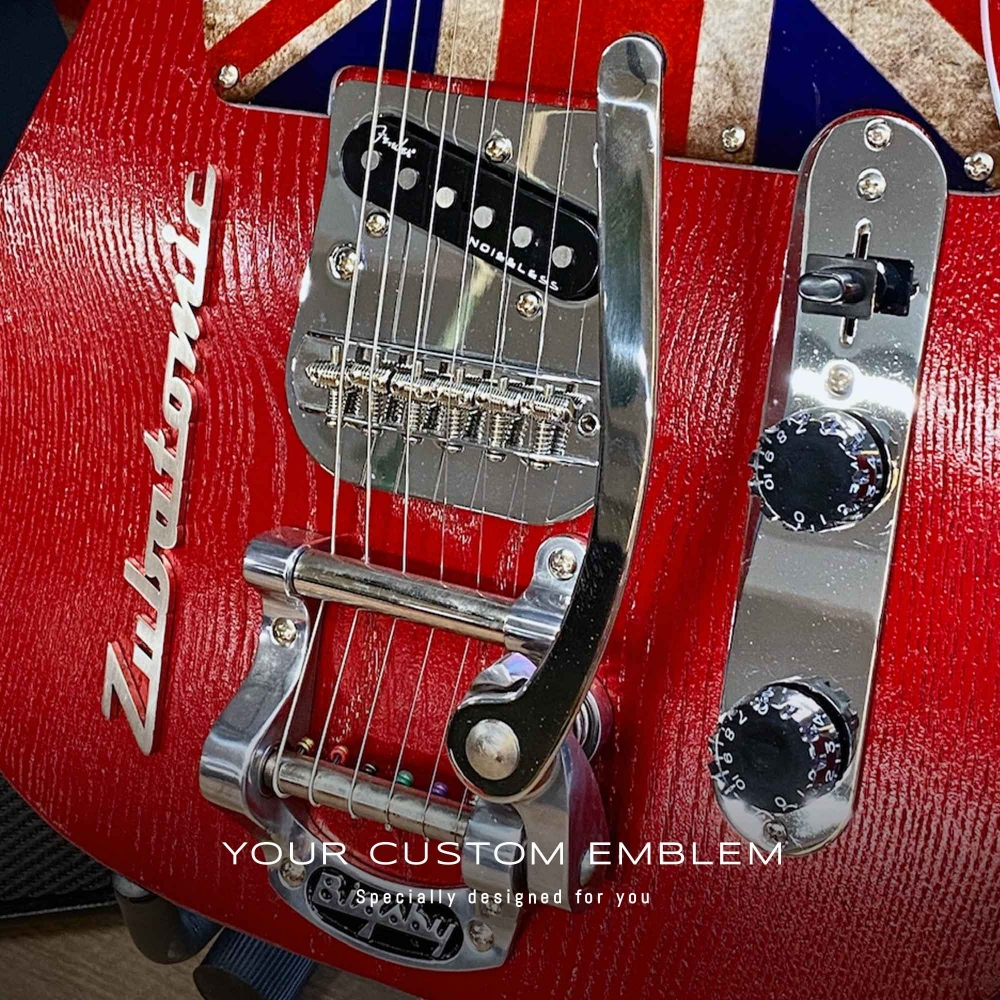 Zubatomic Emblem in stainless steel matt finishing installed on his Guitar