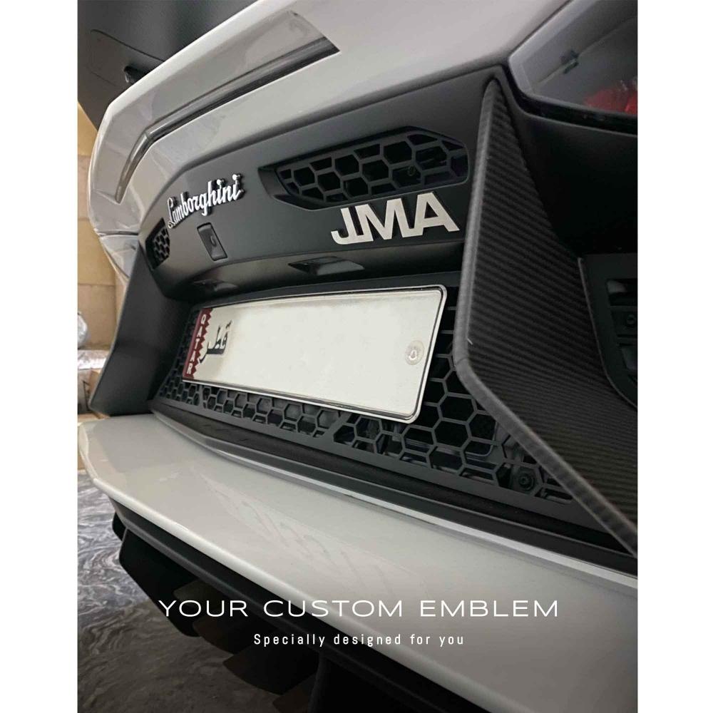 JMA Emblem in stainless steel matt finishing installed on the Lamborghini Aventador SV