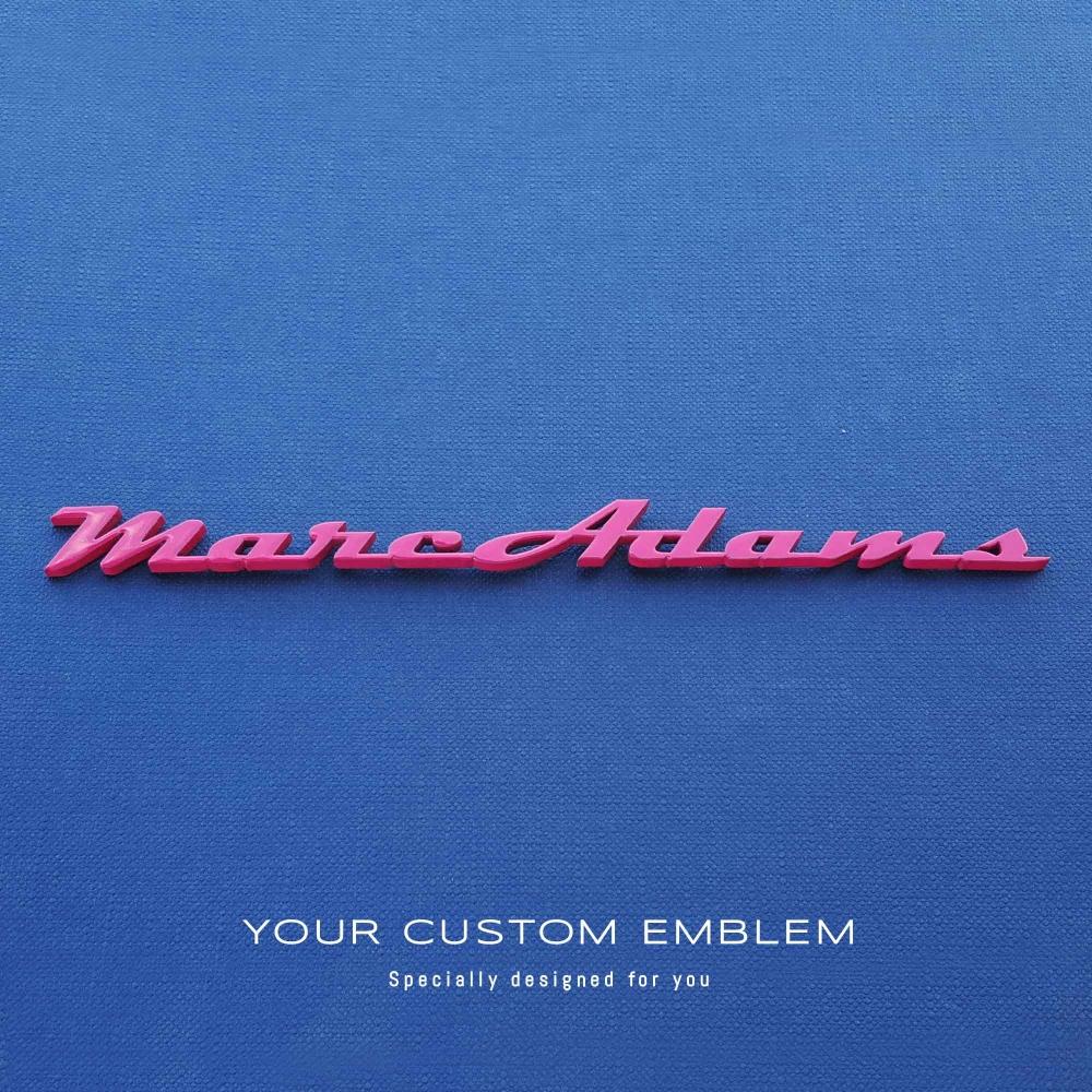 Marc Adams's custom made emblem painted in pink