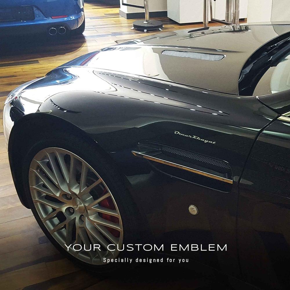 Omar Khayat's Emblem on his Aston Martin