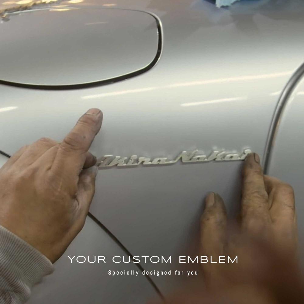 Akira Nakai installing his own Emblem on his personal RWB Porsche